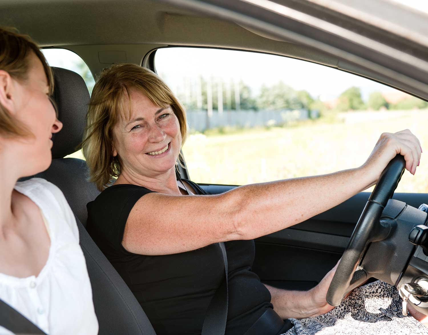 Smiling lady driving