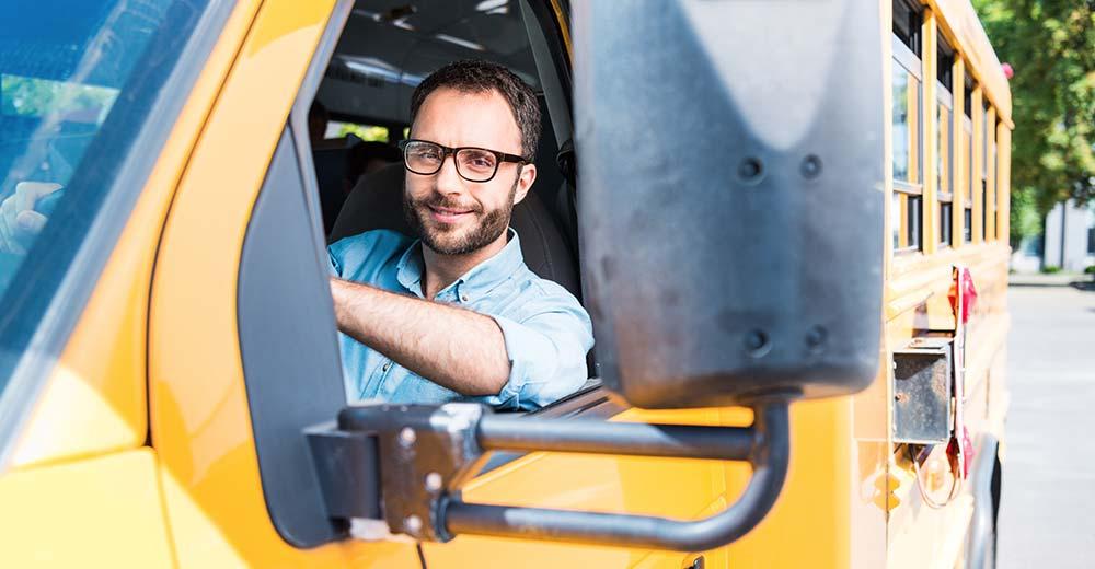School bus driver behind the wheel of a school bus